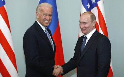 Then US Vice President Joe Biden, left, shakes hands with then Russian Prime Minister Vladimir Putin in Moscow, Russia, March 10, 2011. (AP Photo/Alexander Zemlianichenko, File)