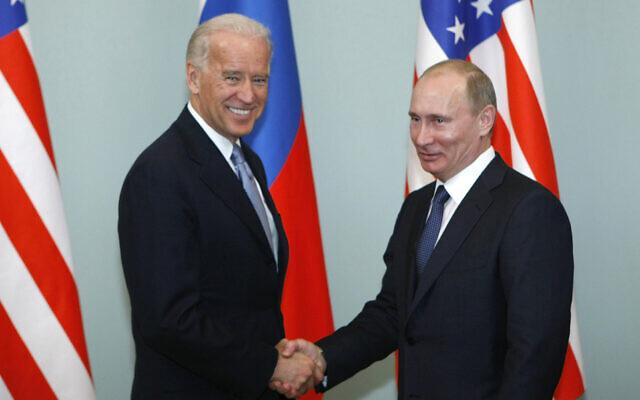 Then-US vice president Joe Biden, left, shakes hands with then Russian Prime Minister Vladimir Putin in Moscow, Russia, March 10, 2011. (AP Photo/Alexander Zemlianichenko, File)