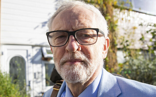 Britain's former opposition Labour Party leader Jeremy Corbyn leaves his home in London, November 18, 2020. (Aaron Chown/PA via AP)