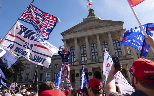 Supporters of US President Donald Trump rally outside of the Georgia State Capitol in Atlanta on November 21, 2020. (AP/Ben Gray)