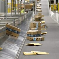 Illustrative: Amazon packages move along a conveyor at an Amazon warehouse facility in Goodyear, Arizona, December 17, 2019. (AP Photo/Ross D. Franklin, File)