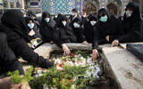 People pray at the grave of Mohsen Fakhrizadeh during his burial in Tehran, Iran, Nov. 30, 2020 (Hamed Malekpour/Tasnim News Agency via AP)