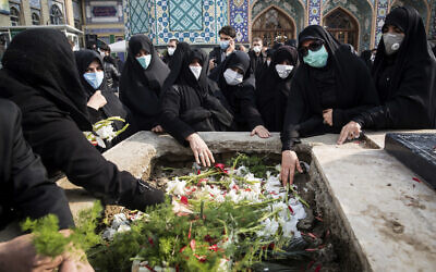 People pray at the grave of Mohsen Fakhrizadeh during his burial in Tehran, Iran, Nov. 30, 2020 (Hamed Malekpour/Tasnim News Agency via AP)