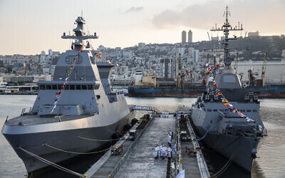The first of four new Sa'ar 6 ships, left, is docked in Haifa on December 2, 2020. (Heidi Levine/Pool Photo via AP)