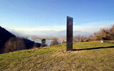 In this Nov. 27, 2020, file photo, a metal structure sticks out from the ground on the Batca Doamnei hill, outside Piatra Neamt, northern Romania (Robert Iosub/ziarpiatraneamt.ro via AP, File)