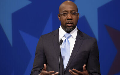 Democratic challenger for U.S. Senate Raphael Warnock speaks during a debate with Republican U.S. Sen. Kelly Loeffler on December 6, 2020, in Atlanta. (AP/Ben Gray, Pool)