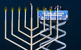 US Secretary of Interior David Bernhardt, center, joined by, from left, Rabbi Abraham Shemtov and Rabbi Levi Shemtov, light the National Hanukkah Menorah on The Ellipse, December 10, 2020 in Washington. (AP Photo/Manuel Balce Ceneta)