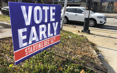 A sign in an Atlanta neighborhood urges people to vote early in Georgia's two US Senate races, on December 11, 2020. (Jeff Amy/AP)