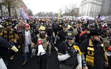 Supporters of US President Donald Trump wearing attire associated with the Proud Boys attend a rally at Freedom Plaza, December 12, 2020, in Washington. (AP Photo/Luis M. Alvarez)