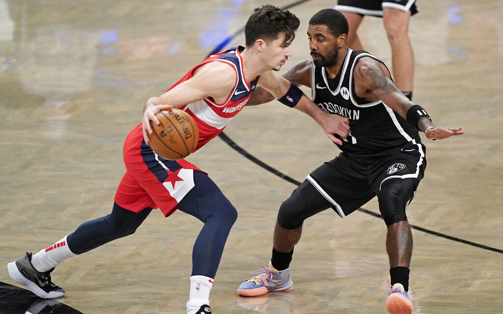 Washington Wizards forward Deni Avdija (L) drives toward during the second quarter of a preseason NBA basketball game in New York, December 13, 2020. (AP Photo/Kathy Willens)