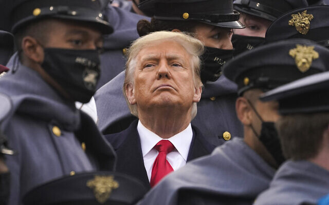 Surrounded by Army cadets, President Donald Trump watches the first half of the 121st Army-Navy Football Game in Michie Stadium at the United States Military Academy, Saturday, Dec. 12, 2020, in West Point, N.Y. (AP Photo/Andrew Harnik)