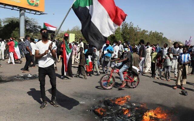 Protesters gather during a demonstration, in Khartoum, Sudan, Saturday, Dec. 19, 2020 (AP Photo/Marwan Ali)