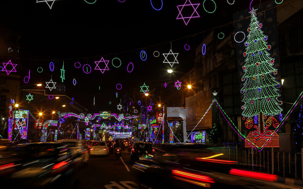 Traffic moves on a street decorated ahead of Christmas in Kolkata, India, Tuesday, December 22, 2020. Though Hindus and Muslims comprise a majority of the population in India, Christmas is a national holiday celebrated with much fanfare. (AP Photo/Bikas Das)