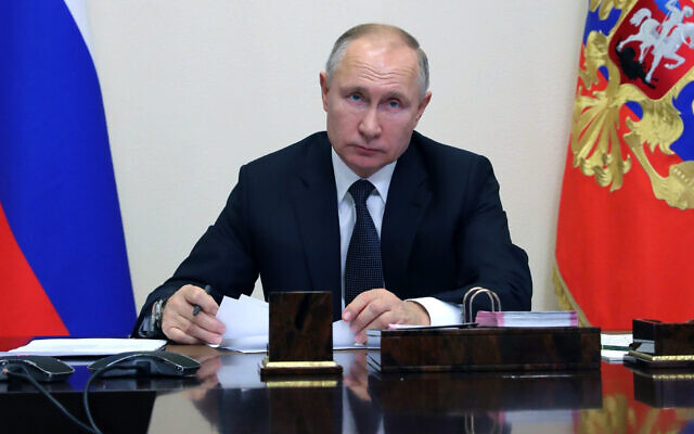 Russian President Vladimir Putin attends a meeting via video conference in Moscow, Russia, December 23, 2020. (Mikhail Klimentyev, Sputnik, Kremlin Pool Photo via AP)