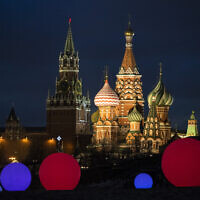 St. Basil Cathedral, right, and Kremlin's Spasskaya Tower, illuminated, as light balls are installed for New Year and Christmas celebrations in Zaryadye Park in Moscow, Russia, December 23, 2020. (Pavel Golovkin/ AP)
