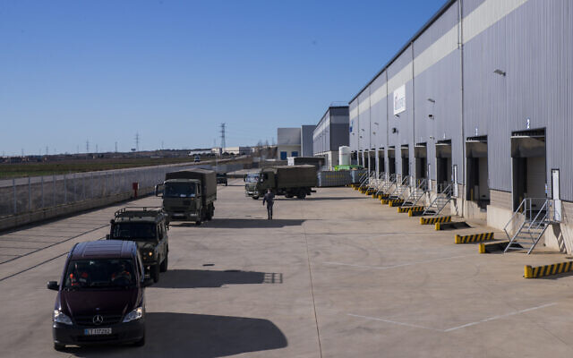 Spanish army convoy carrying the first batch of the Pfizer coronavirus vaccine leaves a warehouse in Cabanillas del Campo, outskirts of Guadalajara, central Spain, Saturday, Dec. 26, 2020 (AP Photo/Bernat Armangue)