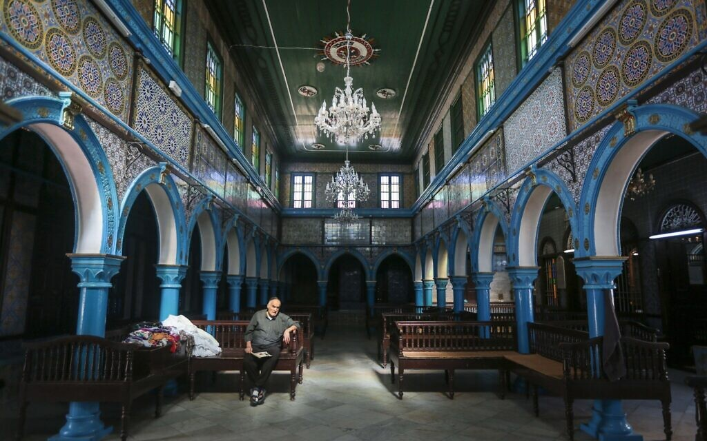 A Jewish Tunisian rests inside the Ghriba synagogue, one the oldest Jewish monuments built in Africa more than 2,500 years ago, on the resort island of Djerba, south of Tunis, Tunisia, Wednesday, Oct. 28, 2015. (AP Photo/Mosa'ab Elshamy)