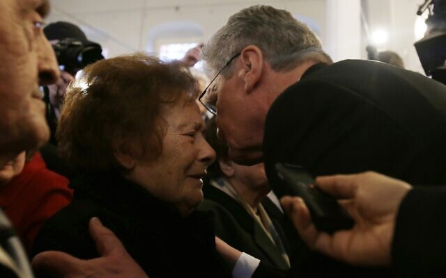 German President Joachim Gauck, right, kisses 93-year-old Esther Cohen,, a Greek Jewish death camp survivor, during his visit at a synagoge in Ioannina, northwestern Greece, on March 7, 2014. (AP Photo/Thanassis Stavrakis)