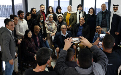 Participants of a delegation from Bahrain and the United Arab Emirates pose for a photograph with residents of the Bedouin town of Zarzir during a visit to Israel on December 16, 2020. (Judah Ari Gross/Times of Israel)