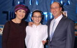The Shaer family's latest project, Happy Birthday Two You, remembers their son, Gil-ad Shaer, center -- who was kidnapped and murdered by Hamas terrorists in 2014 -- by bringing together Jews around the world with the same birthdate (Courtesy Bat-Galim Shaer)