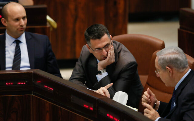 Prime Minister Benjamin Netanyahu (right) in the Knesset on July 29, 2013, with Naftali Bennett (left) and Gideon Sa'ar. (Miriam Alster/FLASH90/File)
