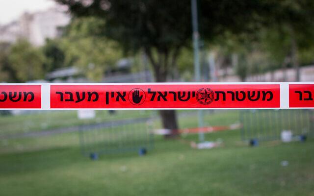 Illustrative -- Police tape hangs in Jerusalem. (Garrett Mills/Flash90)