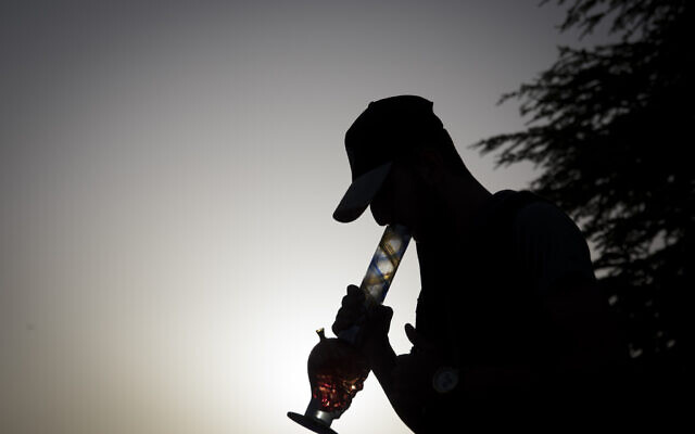 Illustrative: A young Israeli smokes  marijuana in Jerusalem, on April 20, 2017. (Yonatan Sindel/Flash90)