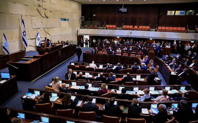 Illustrative: Parliament members vote on a bill to dissolve the parliament, at the Knesset in Jerusalem, on December 11, 2019. (Olivier Fitoussi/Flash90)