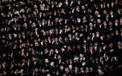 Illustrative: Ultra-Orthodox Jewish men at an event in Jerusalem on February 10, 2020. (Aharon Krohn/Flash90)