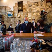 Yisrael Beytenu leader Avigdor Liberman tours the Hacarmel Market in Tel Aviv on November 23, 2020. (Miriam Alster/Flash90)
