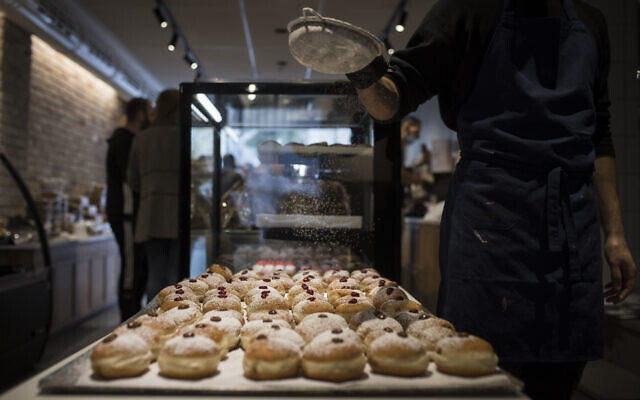 Sufganiyot on sale at Gagou de Paris bakery in downtown Jerusalem, ahead of the Jewish holiday of Hanukkah, on November 26, 2020. (Hadas Parush/Flash90)