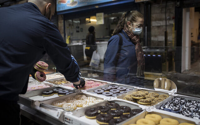 'Sufganiyot' donuts sold at a bakery in the Mahane Yehuda Market, Jerusalem, ahead of the Jewish holiday of Hanukkah, on November 26, 2020. (Hadas Parush/Flash90)