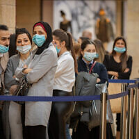 Jerusalemites wearing face masks shop at the Mamilla mall in Jerusalem on December 1, 2020. (Olivier Fitoussi/Flash90)