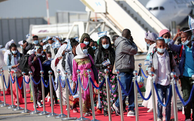 Members of the Ethiopian Jewish community arrive at  Ben Gurion airport, outside Tel Aviv, on December 3, 2020. (Miriam Alster/Flash90)