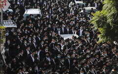 Ultra-Orthodox Jewish man attend the funeral of Rabbi Aharon David Hadash, spiritual leader of the Mir Yeshiva, on December 3, 2020, in Jerusalem. (Yonatan Sindel/Flash90)