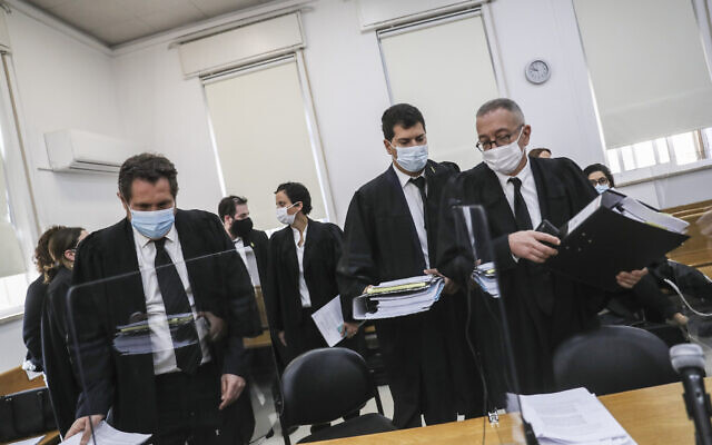 Prime Minister Benjamin Netanyahu's lawyers, Boaz Ben Tzur (right) and Amit Hadad (second right), at the Jerusalem District Court for a hearing on December 6, 2020. (Yonatan Sindel/Flash90)