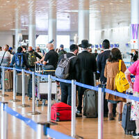 Passengers at the Ben Gurion Airport departure hall on December 14, 2020 (Yossi Aloni/Flash90)