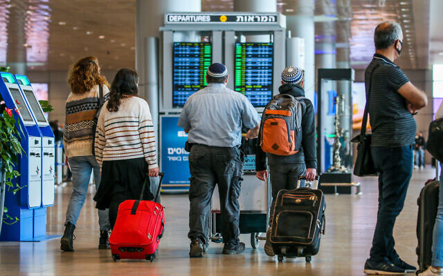 Travelers at the departure hall at Ben Gurion Airport on December 14, 2020. (Yossi Aloni/Flash90)
