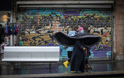 People walk in Jerusalem on December 16, 2020. (Olivier Fitoussi/Flash90)