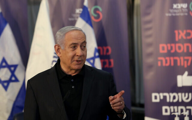 Prime minister Benjamin Netanyahu speaks to the media after receiving the the first vaccination against the coronavirus in Israel, at Sheba hospital in Ramat Gan, on December 19, 2020. (Flash90)