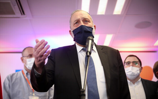 Interior MInister Aryeh Deri speaks to reporters after receiving a COVID-19 vaccine in Jerusalem on December 20, 2020. (Yonatan Sindel/Flash90)
