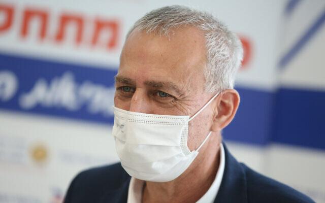 Israel's coronavirus czar Prof. Nachman Ash visits the Ziv hospital in Safed, December 24, 2020 (David Cohen/Flash90)