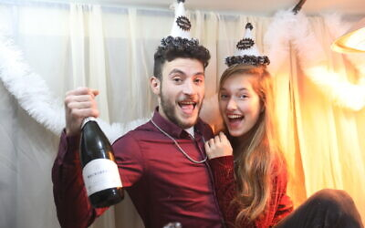 An Israeli couple celebrates New Year's Eve, in central Israel, December 31, 2020. (Yossi Aloni/FLASH90)