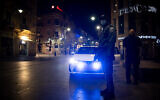 Israel Police offices patrol on Jaffa Street in Jerusalem on New Year's Eve, during the country's third lockdown due to the COVID-19 pandemic, December 31, 2020. (Yonatan Sindel/Flash90)