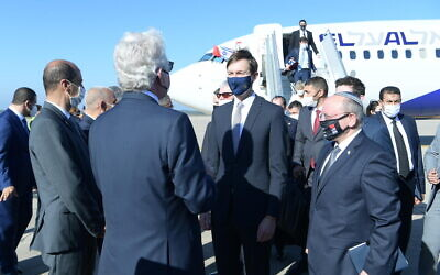 A joint Israel-US delegation, led by Meir Ben-Shabbat (right) and Jared Kushner (center) is greeted on landing in Rabat, after the first direct flight between Israel and Morocco, December 22, 2020 (Amos Ben-Gershom/GPO)