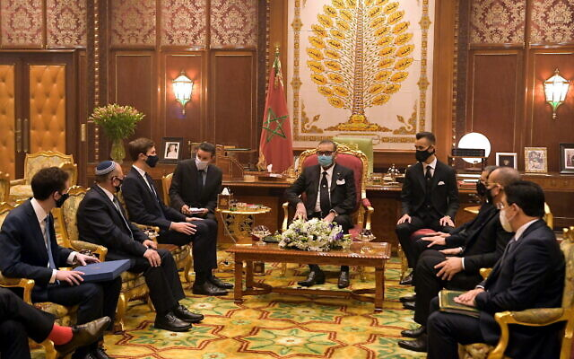 Israeli National Security Adviser Meir Ben-Shabbat (2nd-L) and White House senior adviser Jared Kushner (3rd-L) meet with Moroccan King Mohammed VI (C) at the royal palace in Rabat, Morocco, December 22, 2020. (Amos Ben Gershom/GPO)
