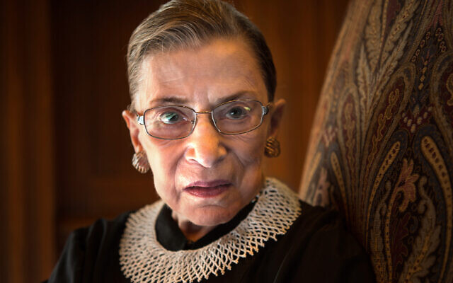 Ruth Bader Ginsburg, celebrating her 20th anniversary as a Supreme Court justice, is photographed in a conference room at the high court in Washington, August 30, 2013. (Nikki Kahn/The Washington Post via Getty Images)