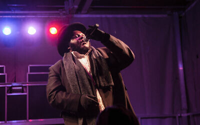Jewish hip hop singer Nissim Black performs at a Hanukkah festival in Pittsburgh, 2018. (Esther Wayne/SOPA Images/LightRocket via Getty Images via JTA)