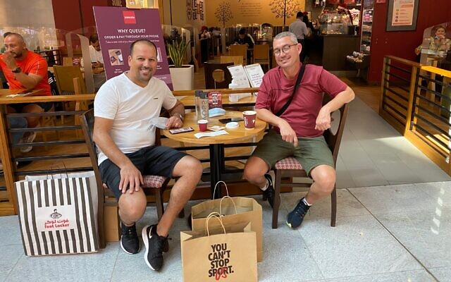 Rafi Revach (left) and Nissim Arush, two Israelis from Dimona visiting the Dubai Mall, December 9, 2020 (Shoshanna Solomon/Times of Israel)