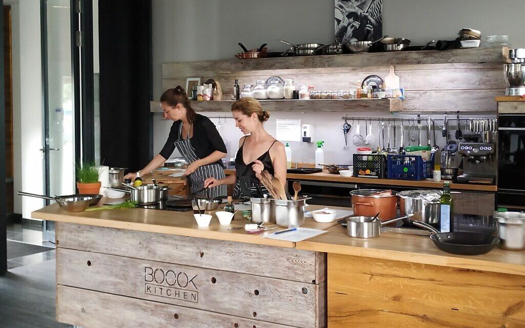 Rachel Raj, center, working in the Boook test kitchen, Budapest, July 2020. (Yaakov Schwartz/ Times of Israel)